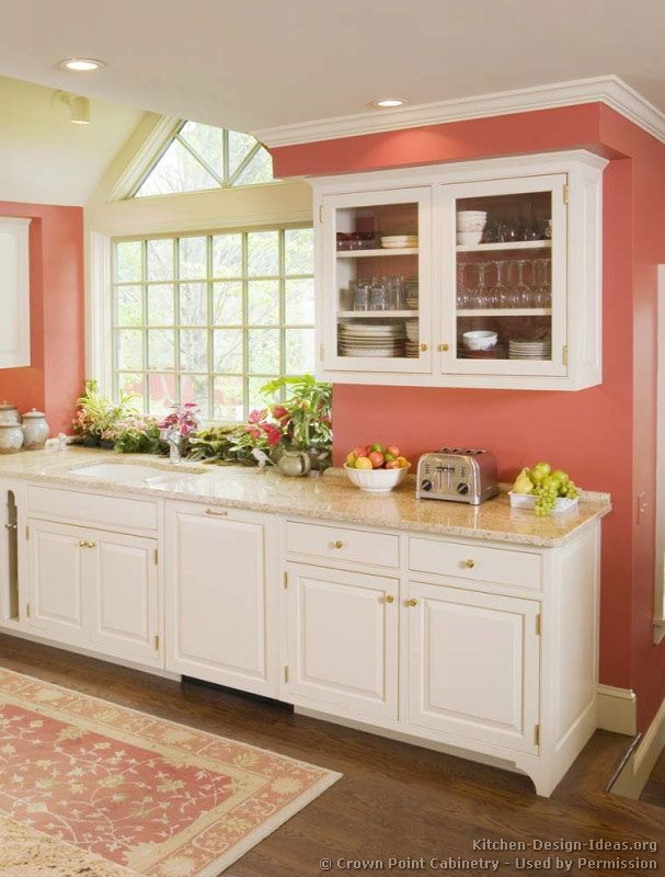#Kitchen Idea of the Day: Traditional White Kitchen with pink walls. (By Crown Point Cabinetry)