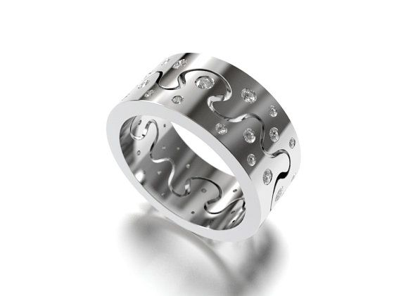Puzzle I ring diamonds on atop by SaarikorpiDesign on Etsy, €3650.00