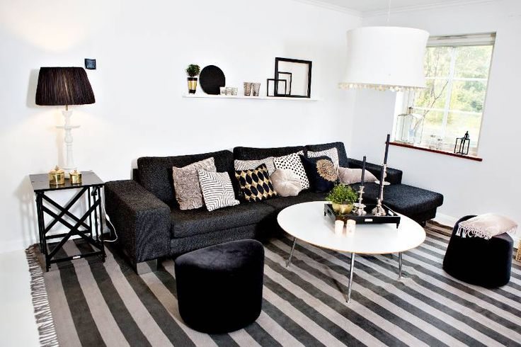 Decorating with a black couch. Needs more color though, but forces one to stay neutral