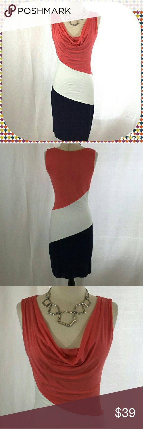 MNG by Mango color block midi dress Stunning body con midi dress from MNG by Mango size XS. Fabric content tags removed but feels like a rayon and spandex blend. Fully lined. Blue cream and salmon color blocking with gorgeous drape neck. 38 inches long. Waist is 28 inches. MNG by Mango Dresses Midi