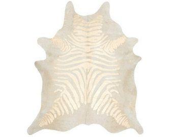 Check out Zebra Printed Cowhide Rug - Gold / Pearl on PuraSpain