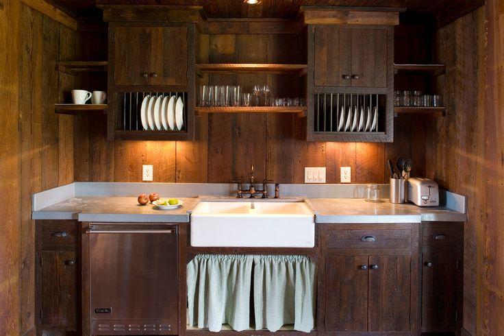 Сушилка для посуды в шкаф: советы по выбору и 70 практичных вариантов для современного интерьера http://happymodern.ru/sushilka-dlya-posudy-v-shkaf/ Сушилки для посуды встроенные в кухонный гарнитур из темного дерева с подсветкой что придает комнате необычайного уюта Смотри больше http://happymodern.ru/sushilka-dlya-posudy-v-shkaf/