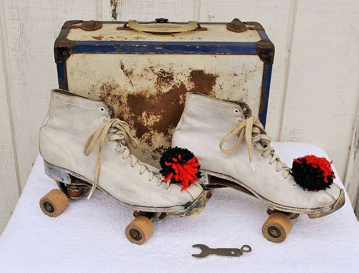 For sale at Retrophoria.com, $30.00 - These white women's roller skates have seen a lot of action! They come with their own key, carrying case, and red and black pom poms. It looks like someone tried to care for them by putting white shoe polish which was customary back then. The case is ru