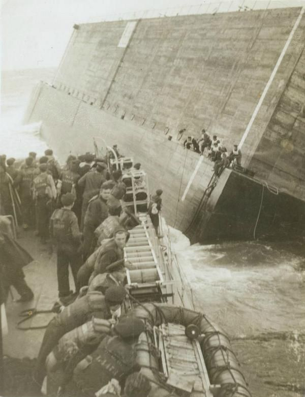 Sailors being rescued from a floating concrete block off Cherbourg on Sept. 24, 1944 [600 × 781] by Robert Pearson on HMCS SWANSEA