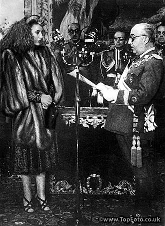 Senora Eva Duarte de Peron with General Franco at a presentation ceremony, when she received  the Grand Cross of Isabel the Catholic.  July 1947