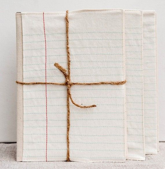 Beautiful embroidered notebook covers (made to look like lined paper) by Pi'lo.