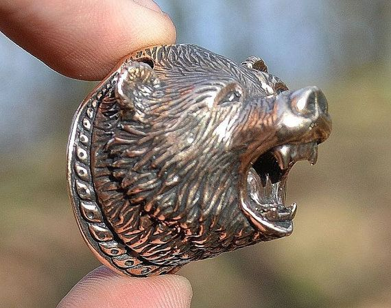 Massive pendant of a bear for real bogatyrs who aren't afraid to wear massive bronze jewel. The bear is decorated with typical early medieval ornaments which are known for example from bone carving (tools, knives) from Slavic and viking lands. Also suitable for example for a handles of knives. Height: 3 cm..