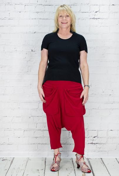 Rundholz 100% cotton short sleeved with little collar t-shirt. Washable. Buttons to reverse and pocket. Worn with Cotton jersey harem trousers, with big pockets at the front. Elasticated waist, really comfy.