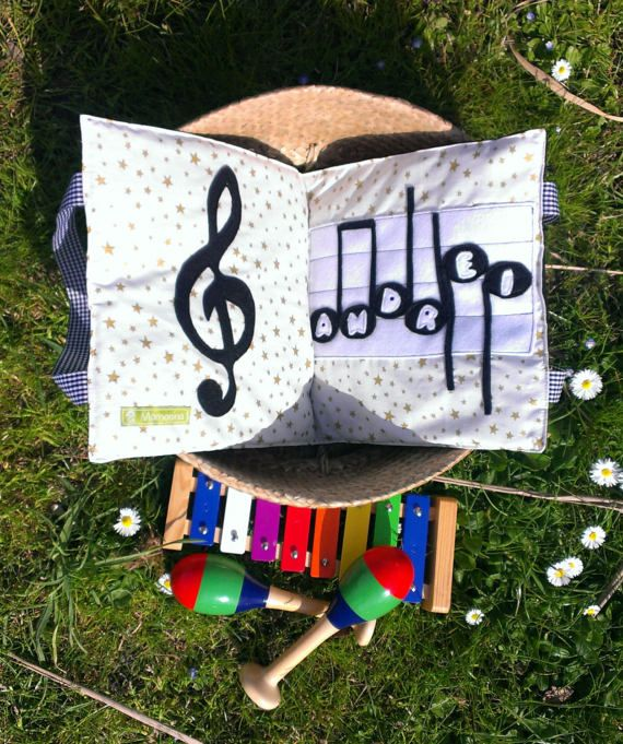 A quiet book full of musical instruments. This book includes 8 pages and a cover. The cover has the name of the child on the first notes from the Happy birthday song and I did another one with the name of the child on the Jesus loves me song The pages of the book include the following