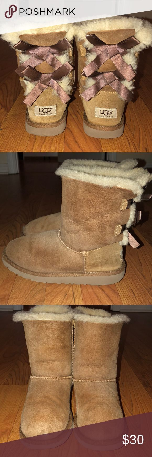 UGG BAILEY BOWS UGG BAILEY BOWS SIZE: 4 (will fit up to 6.5) COLOR: CHESTNUT *** these need a good cleaning. They were very loved! Still have tons of life left. Small hole on toe of right boot. Can be fixed or leave as is. Still look great on! Still very comfortable*** I am open to all reasonable offers❤️ UGG Shoes Winter & Rain Boots