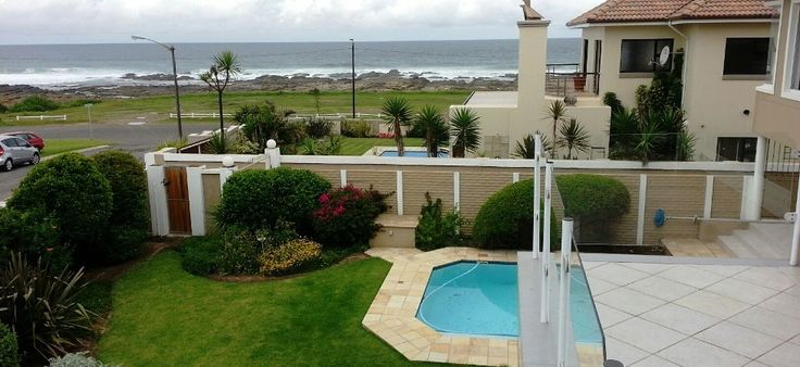 Magnificent, double-storey beach-front  home in Gonubie, featuring, 4 bedrooms, 3 living rooms, double garage, swimming pool a large entertainment area and stunning sunsets!