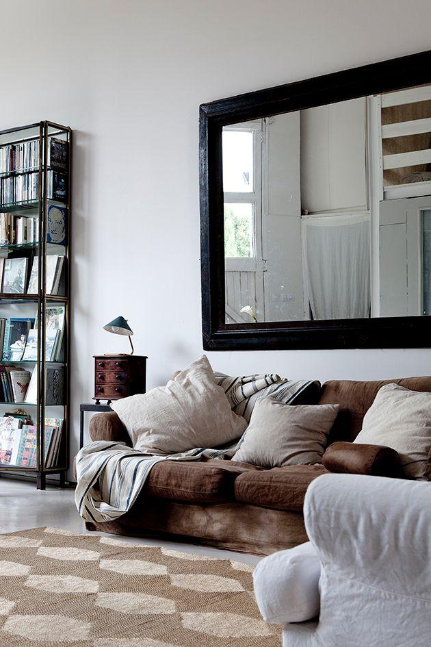 large mirror above sofa
