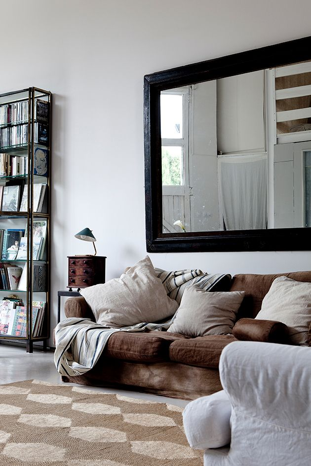 Large mirror above sofa decor wall behind sofa for Big wall mirror for living room