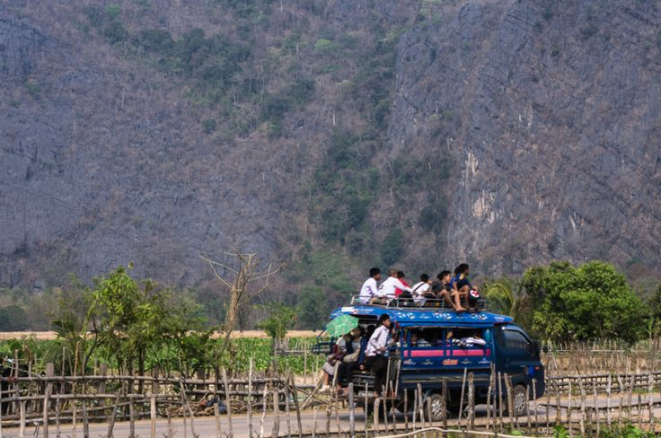 Kids in a songthaew, Laos