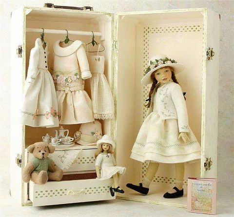 Doll in a suitcase    carrying case, dress-up, toy, play set