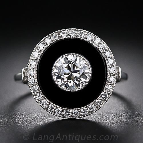 Art Deco Style Black Onyx and Diamond Ring A dramatic Art Deco style ring, superbly crafted in platinum and centered with a beautiful, vintage .85 carat European-cut diamond and featuring contrasting black onyx and a halo of bright-white diamonds - a classic Art Deco combo.