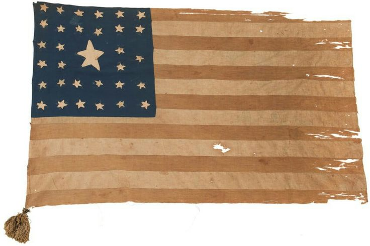 "Rare Pattern Character Laden 32-Star American Flag Captured at 1st Bull Run by Thomas Cawood, Co. K, 3d Tennessee Infantry (Mounted) CSA. Cawood served with the 3d Tennessee until his discharge in 1864 and was present at 1st Bull Run. The flag is 43"" on the hoist and 57"" on the fly, constructed entirely by hand of cotton, exhibiting several different weaves. Thirty one 1¾"" cotton stars with the large central star measuring 6"" from tip to tip, the canton being 22½"" x 24"". (Continued in…"