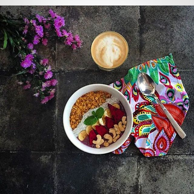 Vegan Acai Bowl & Coffee latte with homemade almond milk  by Avocado cafe Bali