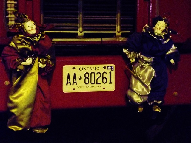 Creepy clowns on the front of a truck