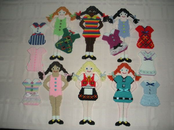 "Plastic Canvas ""Paper"" Dolls - how cute is this, doll buttons are metal brads and clothes are backed with magnetic strips - ingenious - love it ;-)"