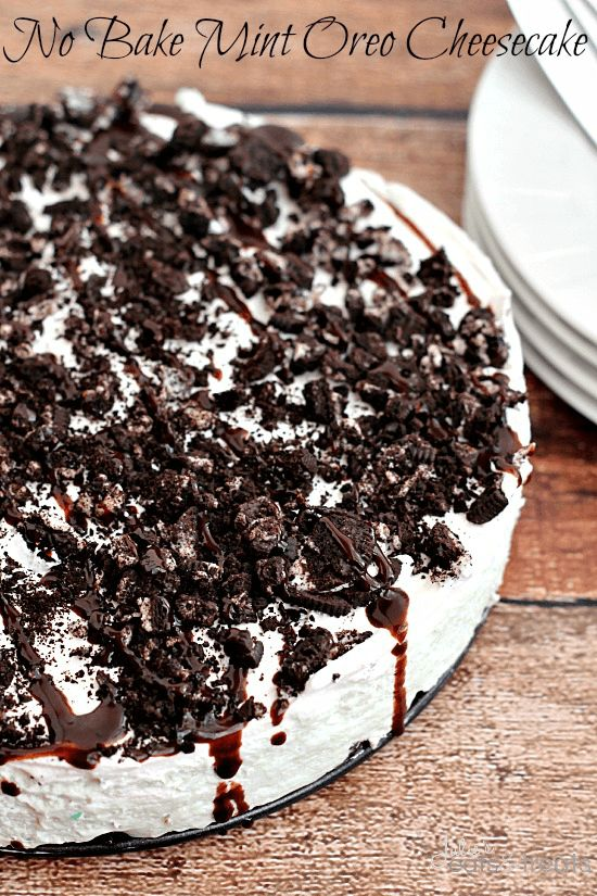 No Bake Mint Oreo Cheesecake ~ Oreo crust piled with light and fluffy cheesecake flavored with mint and topped with crushed Oreos and chocolate syrup!