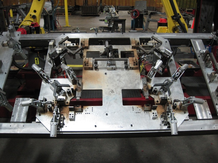 Robotic Weld Cell Weld Jig With Locating Pins And De
