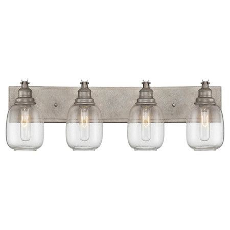 This stylish vanity light showcases a steel finish and vintage-inspired glass shades for industrial appeal.  Product: Vanity lig...