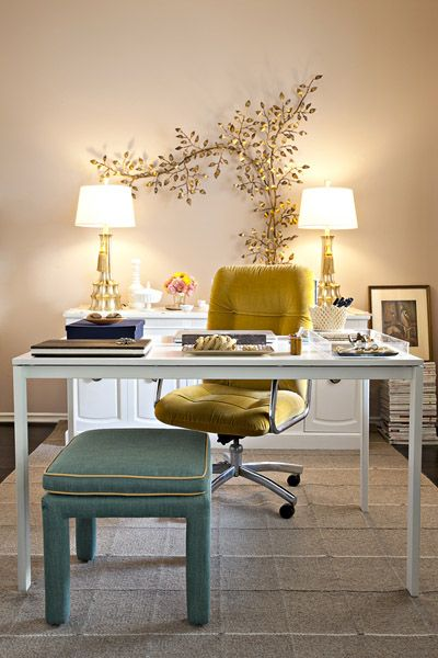 Love the yellow velvet chair, brass ornamentation, tailored pale blue, and modern desk combo.