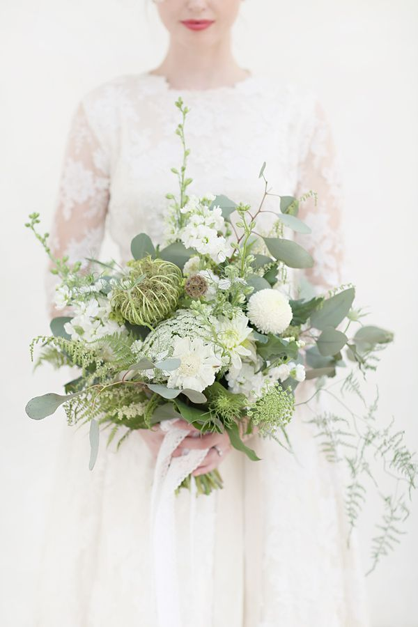White on White, With A Touch of Gold // White and green wedding bouquet // Photography by http://www.craigsandersphotography.co.uk/