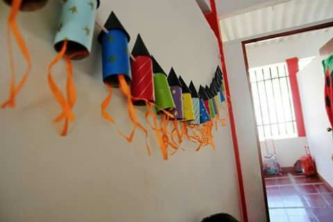 Toilet paper roll rocket ship craft to string on wall.-Christine