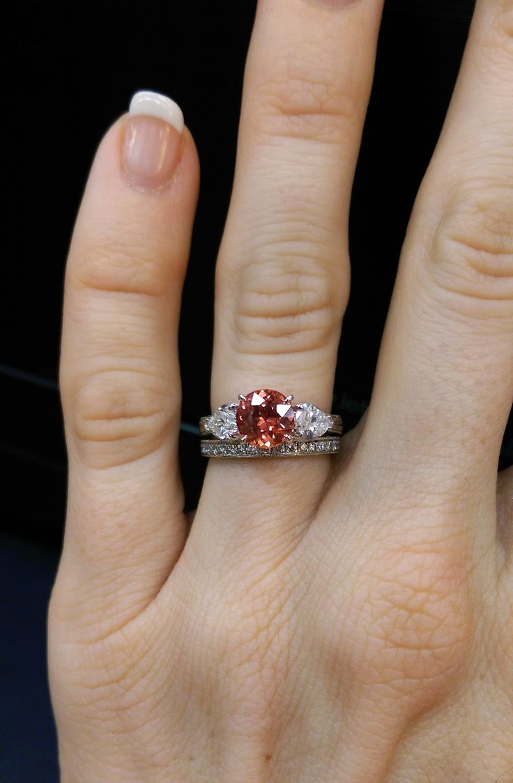 Round Diamond With Pear Side Stones