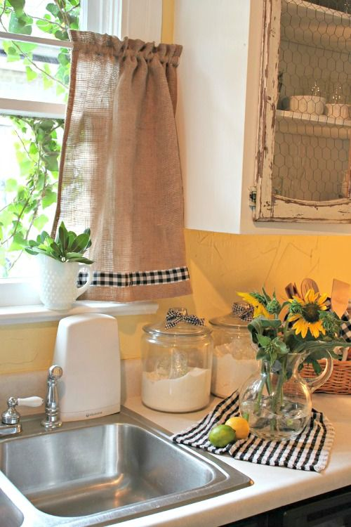 I like the burlap with the black and white checkered trim on the curtain and dish towel. It goes great with the yellow walls in the kitchen.