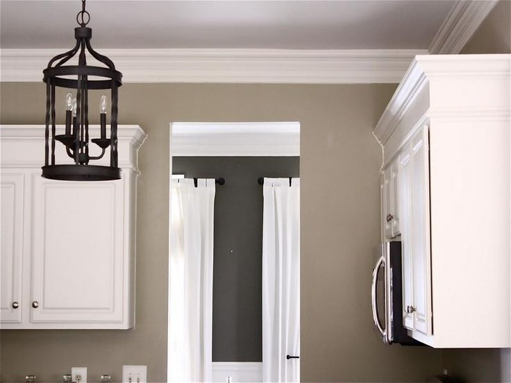 Marvelous perfect color for a kitchen and I like the dark color in the adjoining room