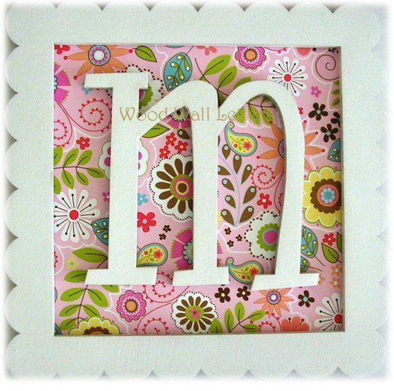 great idea for monogram.  Remove glass from frame and use scrapbook paper for background-or you could mount the letter on top of the glass