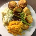 A Sunday Lunch with crunchy roasties, crispy yorkshires, mashed carrot and swede, cauliflower in white sauce, and no meat. A Meatless Sunday Lunch, 57p a serving