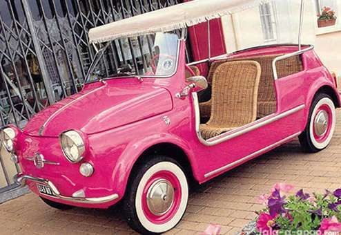 """Pink Fiat 500 Jolly with wicker seats --- too cute! Manufactured by Ghia in the late 1950s as a beach-side auto for Mediterranean playboys. This little baby had wicker seats, removed side panels, a """"surrey-with-the-fringe-on-top"""" & came in a bunch of granita-like colors. The Jolly is perfect for seaside picnics & a red checkered tablecloth, a nice bottle of white wine and a caprese salad. Jackie O had one when she was married to Aristotle Onassis & so did Grace Kelly."""