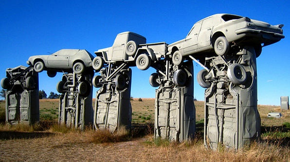 Carhenge features 38 vintage American cars planted in the ground or stacked upon each other and positioned in a circle.