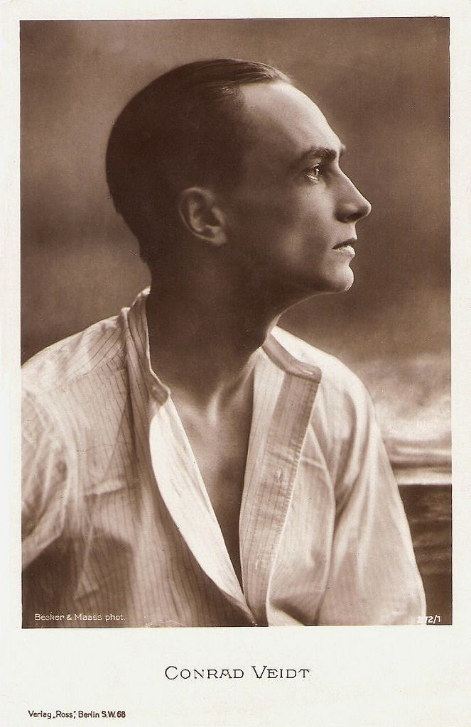 https://flic.kr/p/BRUjSq | Conrad Veidt | German postcard by Ross Verlag, no. 272/1, 1919-1924. Photo: Becker & Maass, Berlin.  Conrad Veidt (1893–1943) was the most highly strung and romantically handsome of the German expressionist actors. From 1916 until his death, he appeared in well over 100 films, including such classics as Das Kabinett des Dr. Caligari/Das Cabinet des Dr. Caligari (Robert Wiene, 1920) and Casablanca (Michael Curtiz, 1942).   For more postcards, a bio and clips che...