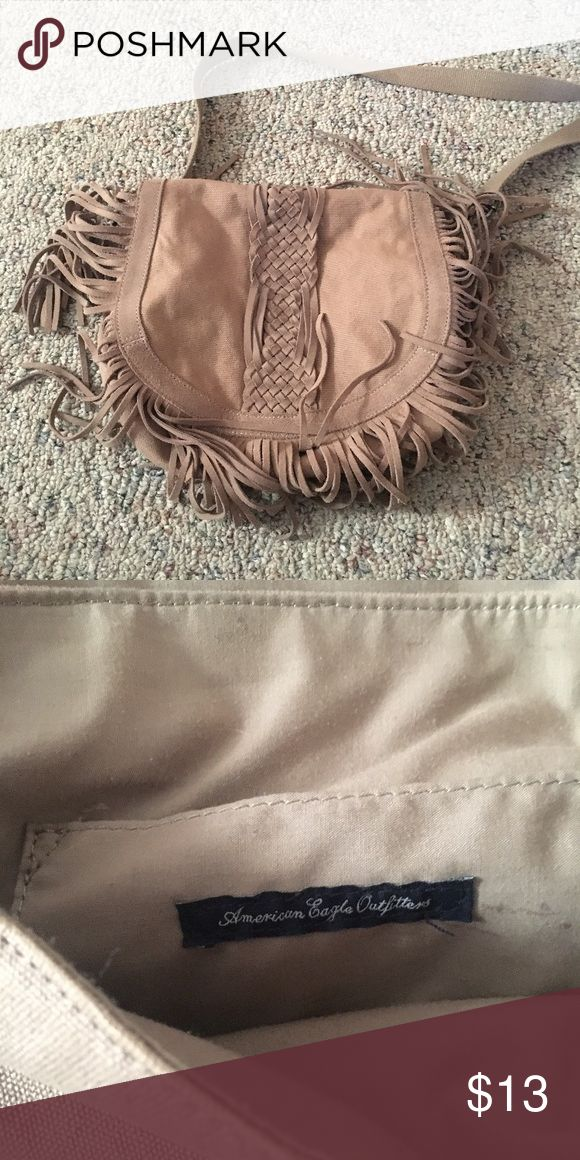 American Eagle handbag American Eagle canvas fringe crossbody bag. Used. In good condition. American Eagle Outfitters Bags Crossbody Bags