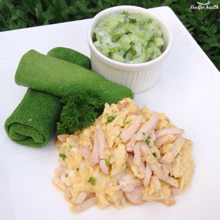 Scrambled egg with smoked chicken, spinach crepes and celery yogurt salad
