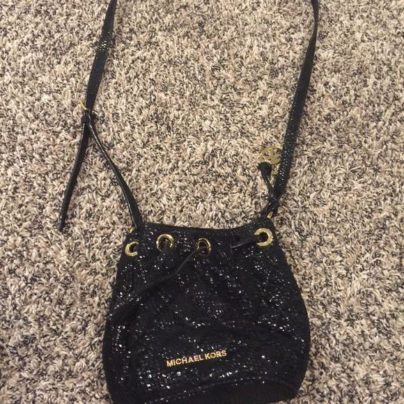 Michael Kors Black purse Black sling with gold accents Michael Kors Bags Crossbody Bags