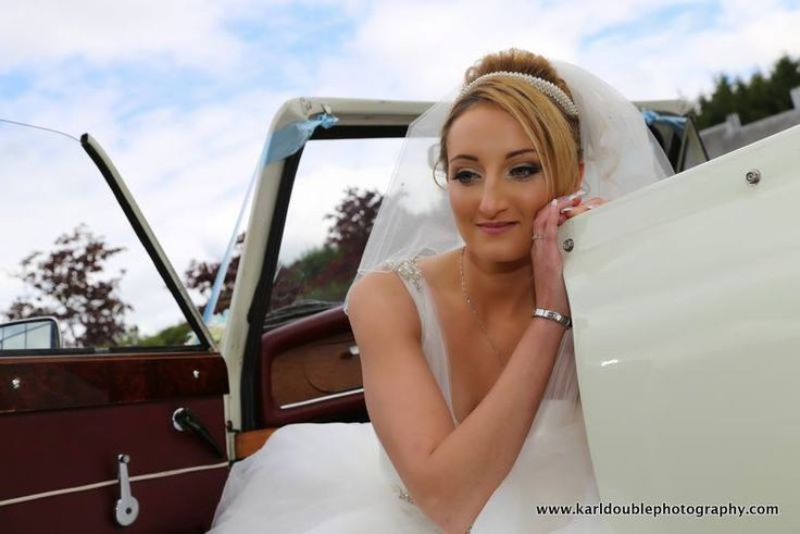 A pensive bride arriving in a Beauford. Available at www.goldchoiceweddingcars.co.uk Photo credit to Karl Double Photography