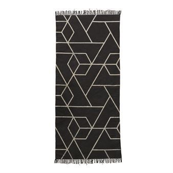 This Phantom rug from House Doctor is a modern cotton rug with classic fringed edges. One can never go wrong with black and white, which makes this a versatile piece for your home. Suitable in the hallway or bedroom, complement this piece with other products from House Doctor.