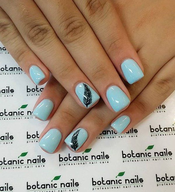 If you're a minimalist then this baby blue nil art design is perfect for you. The nails use baby blue polish as the overall base color with black polish for the feather details on top of the nails.