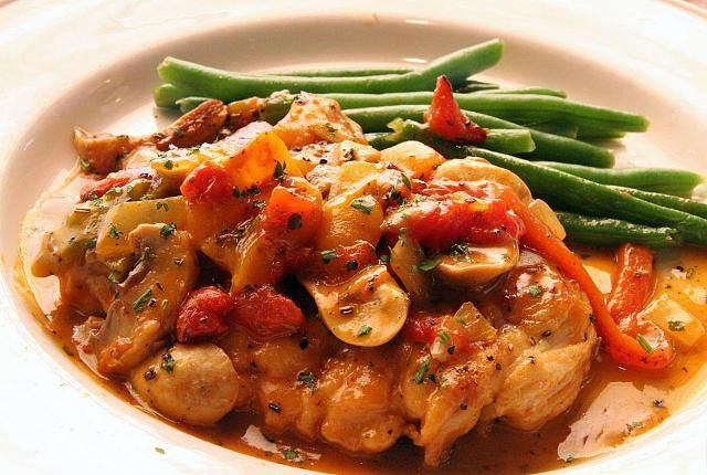 Chicken cacciatore with onions and mushrooms in a tomato sauce. Serve this crockpot chicken cacciatore recipe with spaghetti.