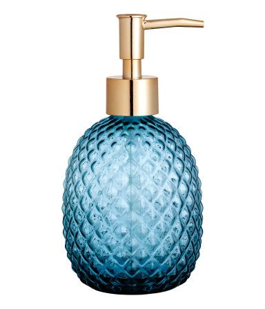 Dark blue. Soap pump in textured glass with a plastic pump at top. Size approx. 3 1/4 x 4 3/4 in.