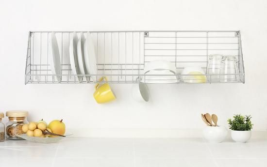 Above: A wall-mounted dish rack frees up countertop space; image via ...