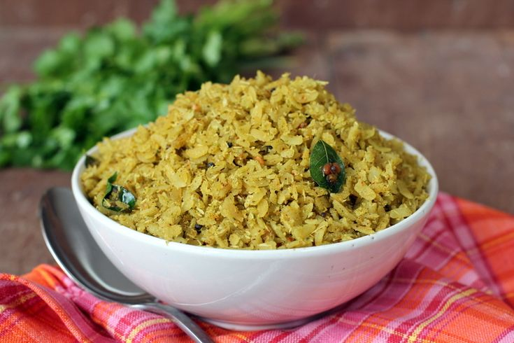 Coriander Poha is a quick, tasty dish among kids tiffin recipes prepared with beaten rice, coconut and coriander leaves.