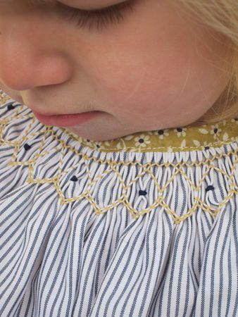 Smocking in navy + mustard