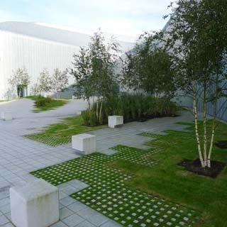 like the idea of bigger pavers transitioning into smaller ones in the grass